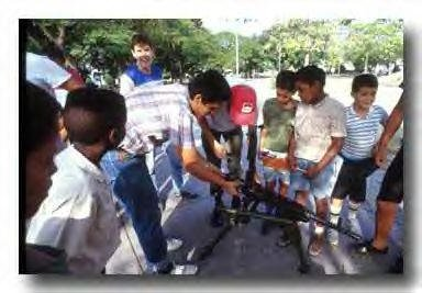 Teaching kids how to use weapons in Cuba