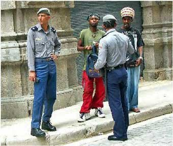 Cuban police stops Cuban in tourist area